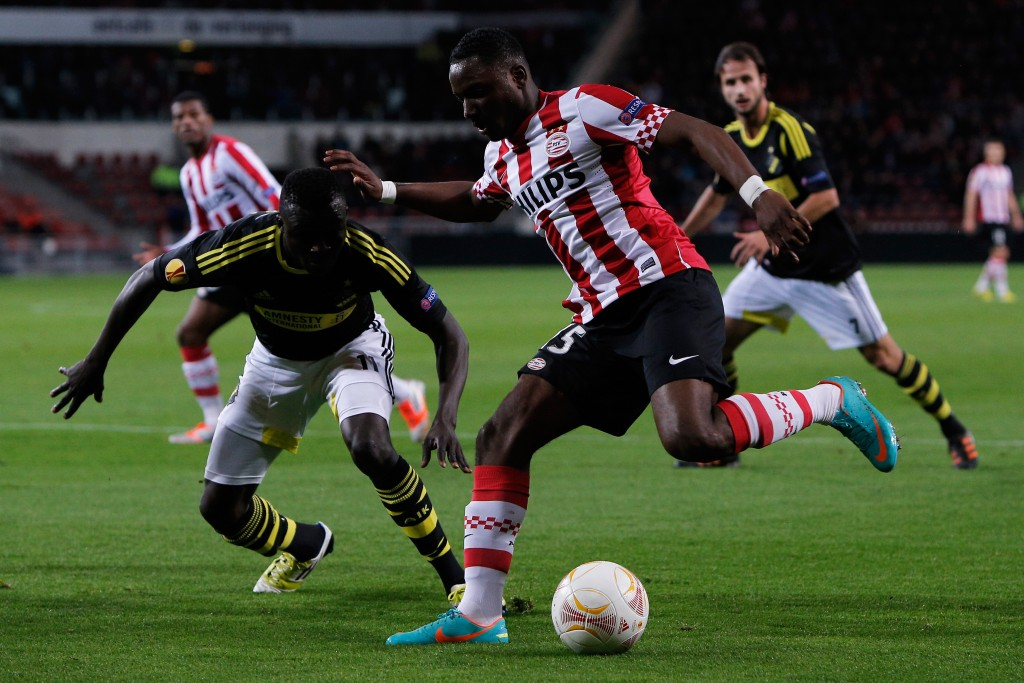 EINDHOVEN, NETHERLANDS - OCTOBER 25: Jetro Willems of PSV and Lalawele Atakora of AIK battle for the ball during the UEFA Europa League Group F match between PSV Eindhoven and AIK Solna at the Philips Stadion on October 25, 2012 in Eindhoven, Netherlands. (Photo by Dean Mouhtaropoulos/Getty Images)