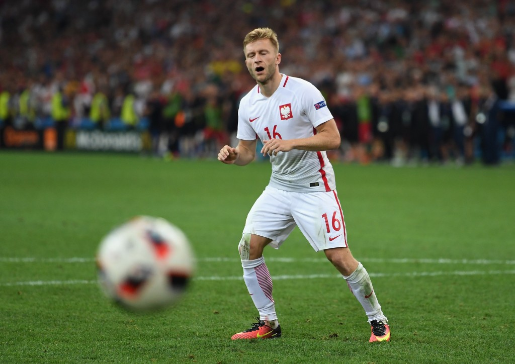 MARSEILLE, FRANCE - JUNE 30: Jakub Blaszczykowski of Poland reacts after the penalty saved by Rui Patricio of Portugal at the penalty shootout during the UEFA EURO 2016 quarter final match between Poland and Portugal at Stade Velodrome on June 30, 2016 in Marseille, France. (Photo by Laurence Griffiths/Getty Images)
