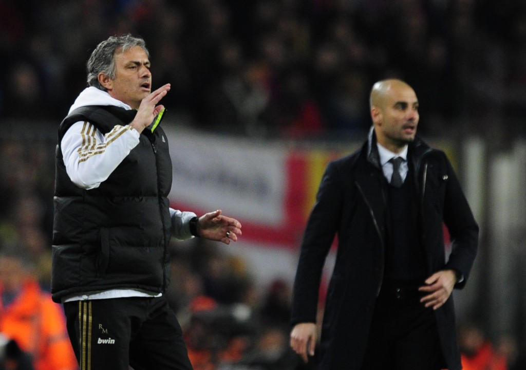 """Real Madrid's Portuguese coach Jose Mourinho (L) gestures in front of Barcelona's coach Josep Guardiola (R) after Real Madrid's defender Sergio Ramos received a red card during the second leg of the Spanish Cup quarter-final """"El clasico"""" football match Barcelona vs Real Madrid at the Camp Nou stadium in Barcelona on January 25, 2012. AFP PHOTO/JAVIER SORIANO (Photo credit should read JAVIER SORIANO/AFP/Getty Images)"""