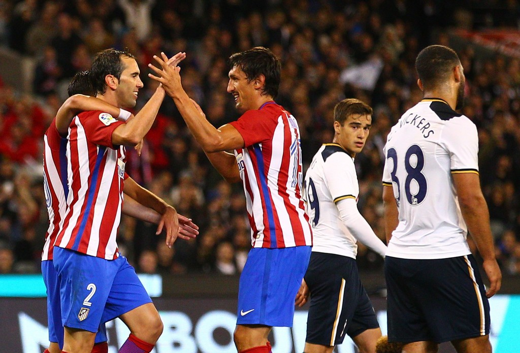 MELBOURNE, AUSTRALIA - JULY 29: Diego Godin of Atletico de Madrid celebrates after scoring their first goal during 2016 International Champions Cup Australia match between Tottenham Hotspur and Atletico de Madrid at the Melbourne Cricket Ground on July 29, 2016 in Melbourne, Australia. (Photo by Scott Barbour/Getty Images)