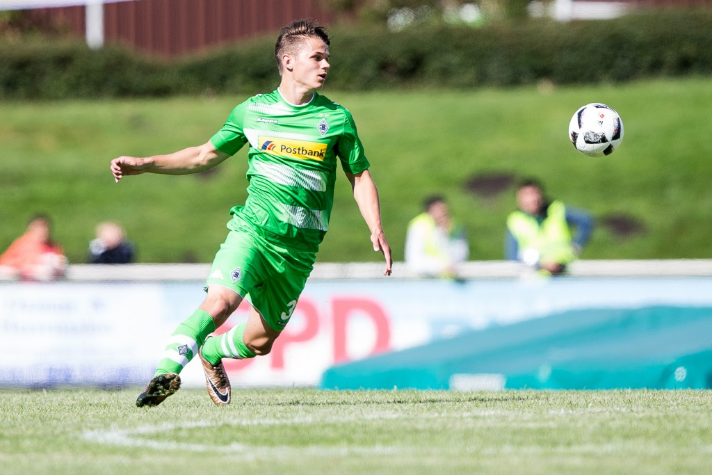 RHEDE, GERMANY - JULY 02: Andreas Christensen of Borussia Moenchengladbach with ball during the friendly match between VfL Rhede and Borussia Moenchengladbach at Besagroup Sportpark on July 2, 2016 in Rhede, Germany. (Photo by Maja Hitij/Bongarts/Getty Images)