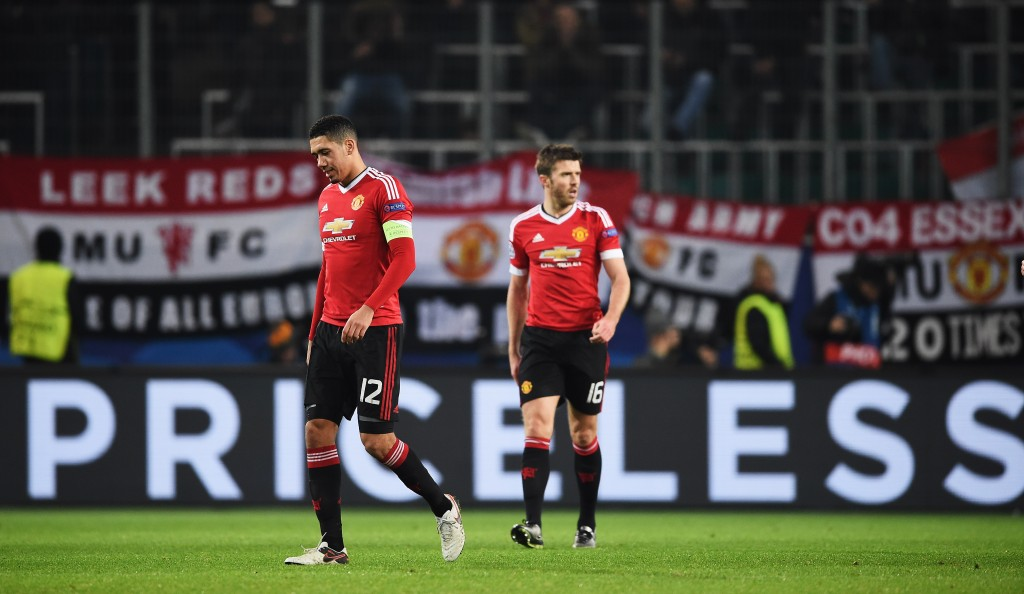 WOLFSBURG, GERMANY - DECEMBER 08: Chris Smalling and Michael Carrick of Manchester look dejected during the UEFA Champions League match between VfL Wolfsburg and Manchester United FC at the Volkswagen arena on December 8, 2015 in Wolfsburg, Germany. (Photo by Stuart Franklin/Bongarts/Getty Images)