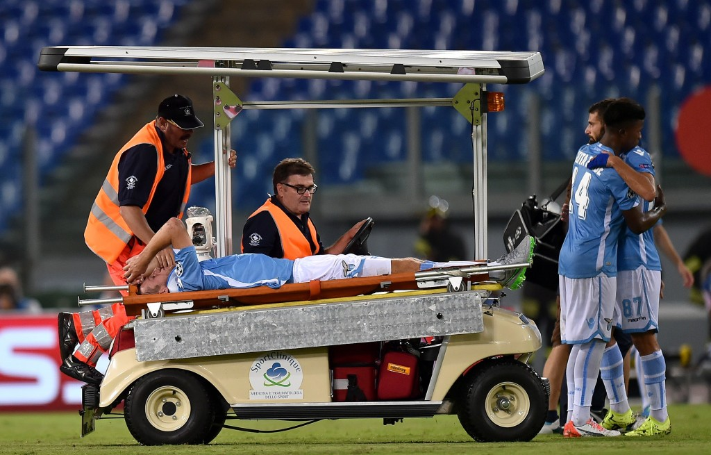 Lazio's defender from Netherlands Stefan de Vrij is carried out of the pitch after getting injured during the UEFA Champions League playoff football match between Lazio and Bayer Leverkusen, at Olympic stadium in Rome on August 18, 2015. AFP PHOTO / ALBERTO PIZZOLI (Photo credit should read ALBERTO PIZZOLI/AFP/Getty Images)