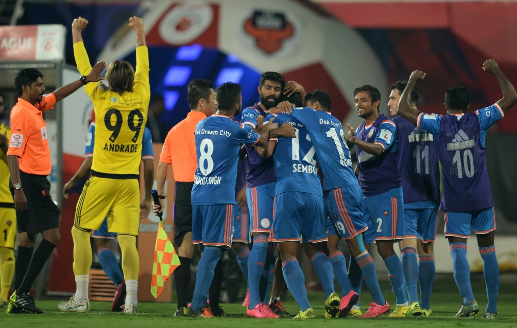 FC Goa players celebrate after a goal during the final match between Chennaiyin FC and FC Goa of the Indian Super League (ISL) football tournament at Jawahar Lal Nehru Stadium in Goa on December 20, 2015. AFP PHOTO / PUNIT PARANJPE / AFP / PUNIT PARANJPE (Photo credit should read PUNIT PARANJPE/AFP/Getty Images)