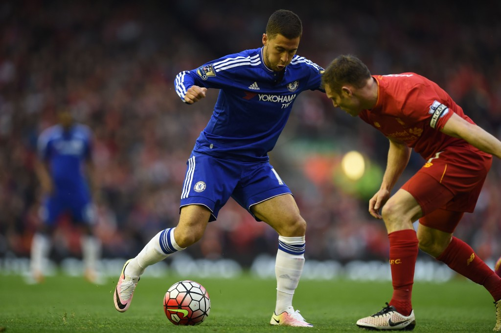 Chelsea's Belgian midfielder Eden Hazard vies with Liverpool's English midfielder James Milner during the English Premier League football match between Liverpool and Chelsea at Anfield in Liverpool, north west England on May 11, 2016. / AFP / Paul ELLIS / RESTRICTED TO EDITORIAL USE. No use with unauthorized audio, video, data, fixture lists, club/league logos or 'live' services. Online in-match use limited to 75 images, no video emulation. No use in betting, games or single club/league/player publications. / (Photo credit should read PAUL ELLIS/AFP/Getty Images)