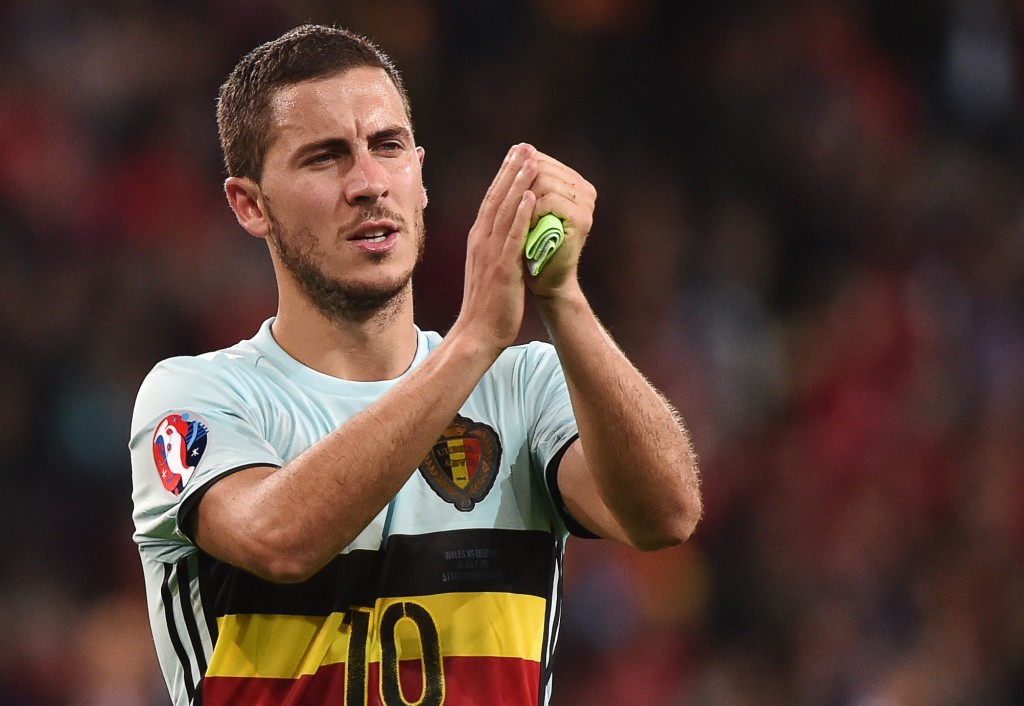 Belgium's forward Eden Hazard acknowledges supporters at the end of the Euro 2016 quarter-final football match between Wales and Belgium at the Pierre-Mauroy stadium in Villeneuve-d'Ascq near Lille, on July 1, 2016. / AFP / PHILIPPE HUGUEN (Photo credit should read PHILIPPE HUGUEN/AFP/Getty Images)