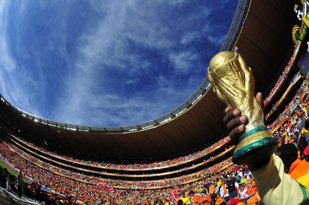 A fan holds a replica Jules Rimet World Cup trophy while watching the game on June 14, 2010, at the 2010 World Cup match Netherlands and Denmark at Soccer City Stadium in Soweto, suburban Johannesburg. Netherlands defeated Denmark 2-0. - NO PUSH TO MOBILE / MOBILE USE SOLELY WITHIN EDITORIAL ARTICLE - AFP PHOTO/Monirul Bhuiyan (Photo credit should read Monirul Bhuiyan/AFP/Getty Images)