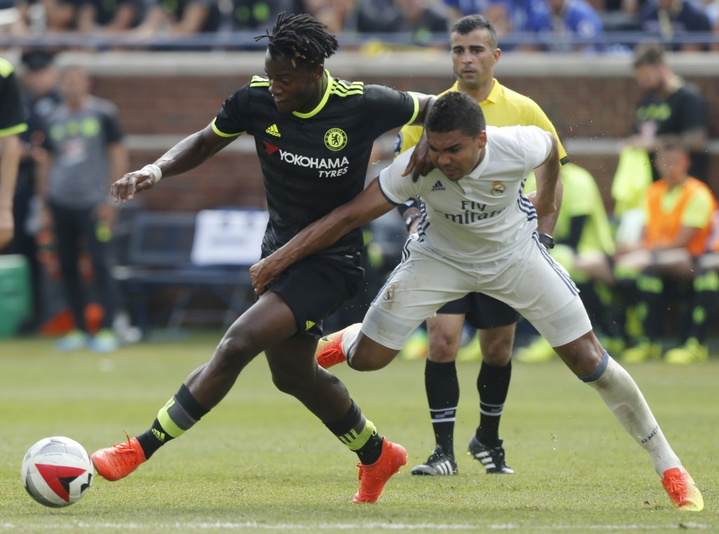 Real Madrid midfielder Carlos Henrique Casemiro (R) tries to steal the ball from Chelsea forward Michy Batshuayi (L) during an International Champions Cup soccer match in Ann Arbor, Michigan on July 30, 2016. / AFP / Jay LaPrete (Photo credit should read JAY LAPRETE/AFP/Getty Images)