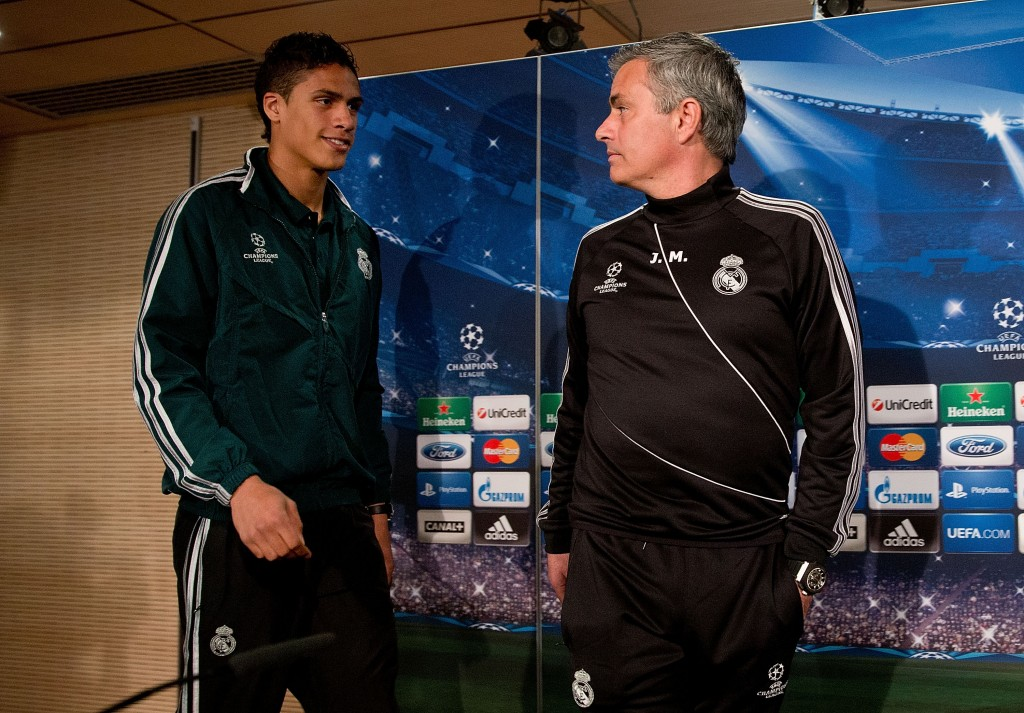 MADRID, SPAIN - APRIL 02:  Head coach Jose Mourinho (R) and Real madrid player Raphael varane prior to start a press conference ahead of the UEFA Champions League Quarterfinal match between Real Madrid and Galatasaray AS at Santiago Bernabeu Stadium on April 2, 2013 in Madrid, Spain.  (Photo by Gonzalo Arroyo Moreno/Getty Images)