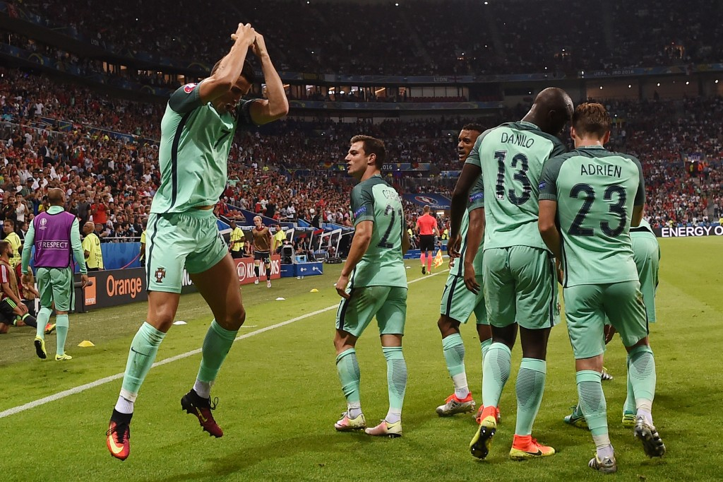 Portugal's forward Cristiano Ronaldo (L) celebrates after scoring a goal during the Euro 2016 semi-final football match between Portugal and Wales at the Parc Olympique Lyonnais stadium in Décines-Charpieu, near Lyon, on July 6, 2016. / AFP / PAUL ELLIS (Photo credit should read PAUL ELLIS/AFP/Getty Images)