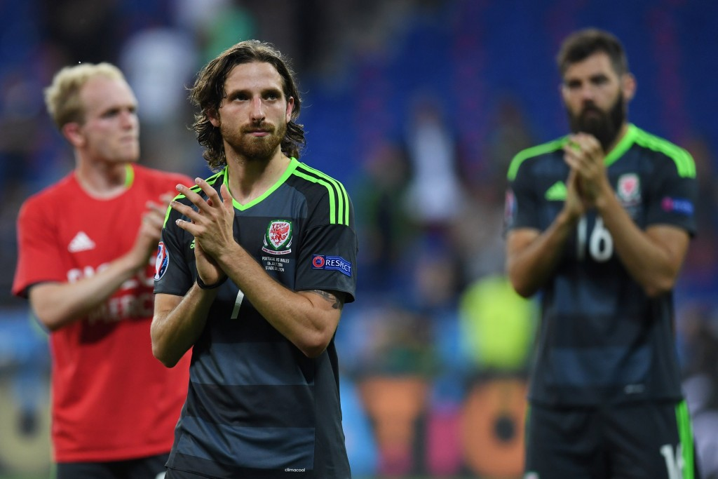 Wales' midfielder Joe Allen reacts at the end of the Euro 2016 semi-final football match between Portugal and Wales at the Parc Olympique Lyonnais stadium in Décines-Charpieu, near Lyon, on July 6, 2016. / AFP / PAUL ELLIS (Photo credit should read PAUL ELLIS/AFP/Getty Images)