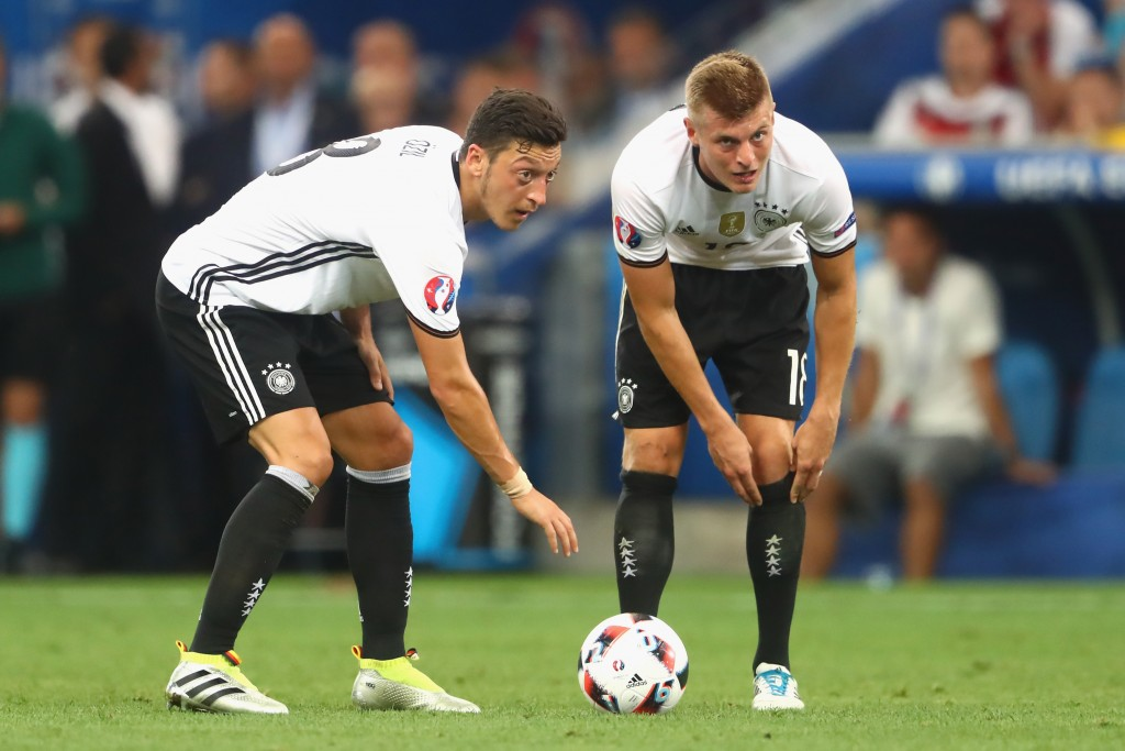 MARSEILLE, FRANCE - JULY 07: Toni Kroos (R) of Germany reacts with his team mate Mesut Oezil during the UEFA EURO semi final match between Germany and France at Stade Velodrome on July 7, 2016 in Marseille, France. (Photo by Alexander Hassenstein/Getty Images)