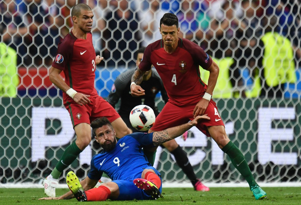 Portugal's defender Pepe (L) and Portugal's defender Fonte vie for the ball with France's forward Olivier Giroud during the Euro 2016 final football match between Portugal and France at the Stade de France in Saint-Denis, north of Paris, on July 10, 2016. / AFP / PHILIPPE DESMAZES (Photo credit should read PHILIPPE DESMAZES/AFP/Getty Images)