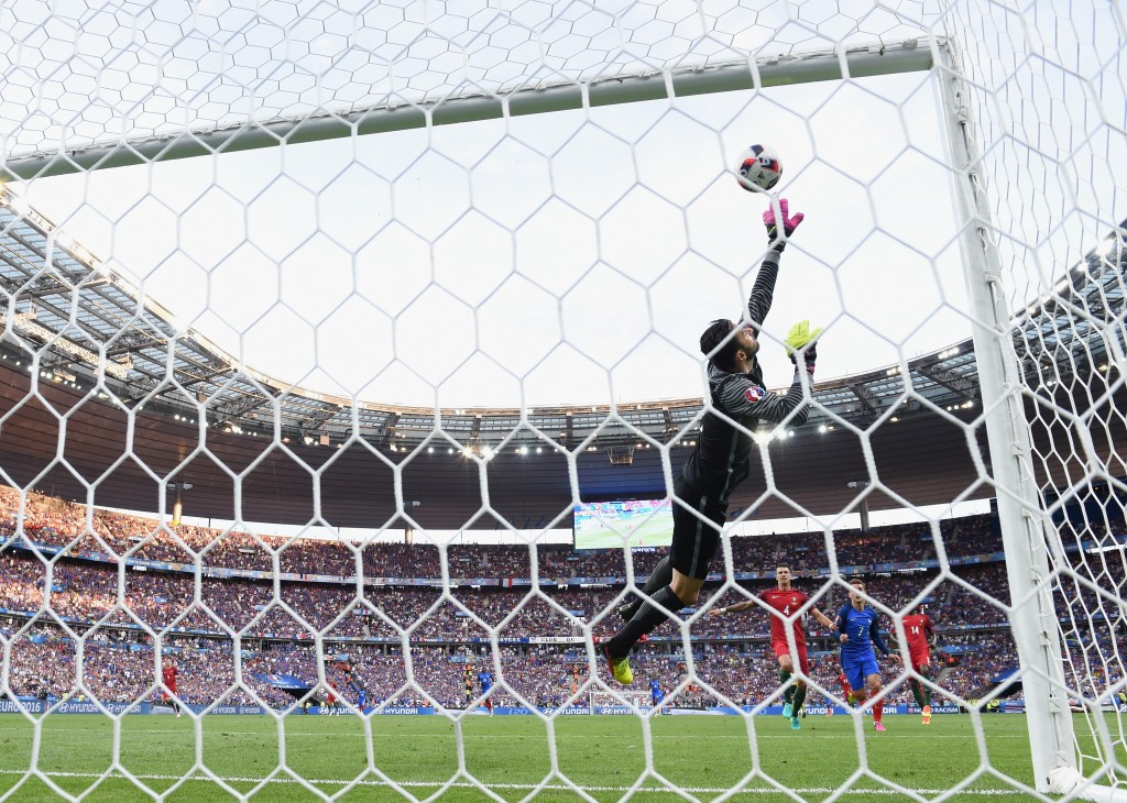 PARIS, FRANCE - JULY 10: Rui Patricio of Portugal makes a save the UEFA EURO 2016 Final match between Portugal and France at Stade de France on July 10, 2016 in Paris, France. (Photo by Matthias Hangst/Getty Images)