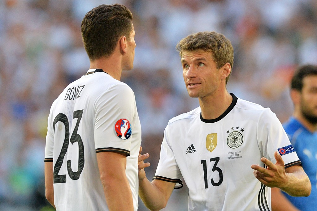 Germany's forward Mario Gomez (L) listens to Germany's midfielder Thomas Mueller during the Euro 2016 quarter-final football match between Germany and Italy at the Matmut Atlantique stadium in Bordeaux on July 2, 2016. / AFP / NICOLAS TUCAT (Photo credit should read NICOLAS TUCAT/AFP/Getty Images)
