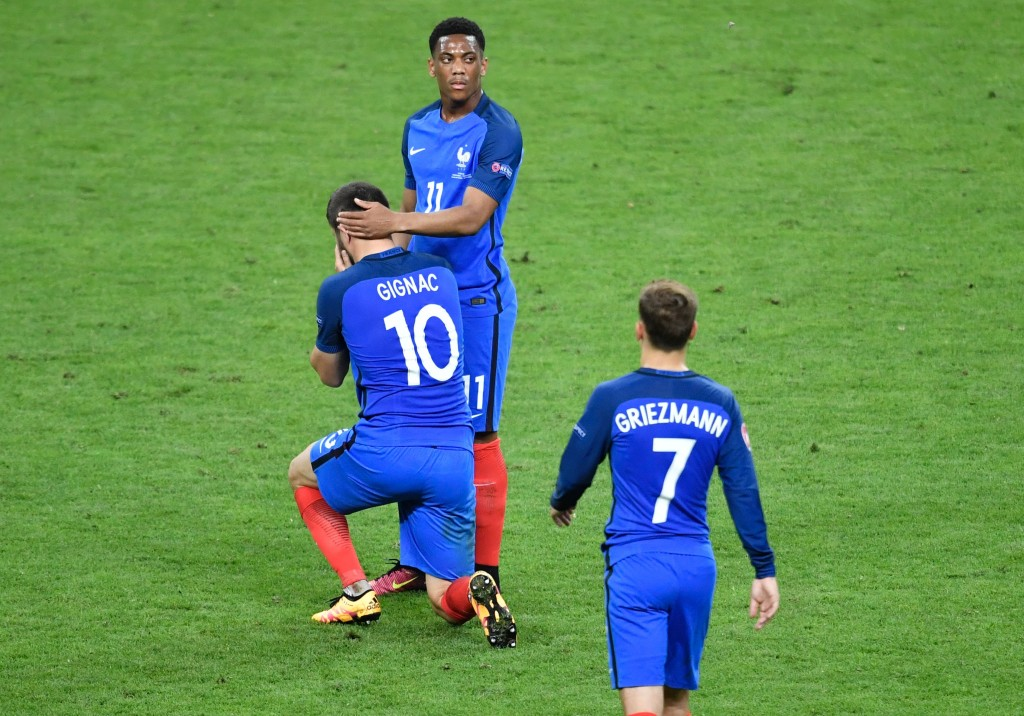 TOPSHOT - (LtoR) France's forward Andre-Pierre Gignac, France's forward Anthony Martial and France's forward Antoine Griezmann react after their team's defeat in the Euro 2016 final football match between Portugal and France at the Stade de France in Saint-Denis, north of Paris, on July 10, 2016. / AFP / PHILIPPE LOPEZ (Photo credit should read PHILIPPE LOPEZ/AFP/Getty Images)