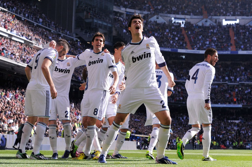 MADRID, SPAIN - MARCH 02: Alvaro Morata (C) of Real Madrid CF celebrates with his teammates after Karim Benzema of Real Madrid CF (L) scored the opening goal during the La Liga match between Real Madrid CF and FC Barcelona at Bernabeu on March 2, 2013 in Madrid, Spain. (Photo by David Ramos/Getty Images)