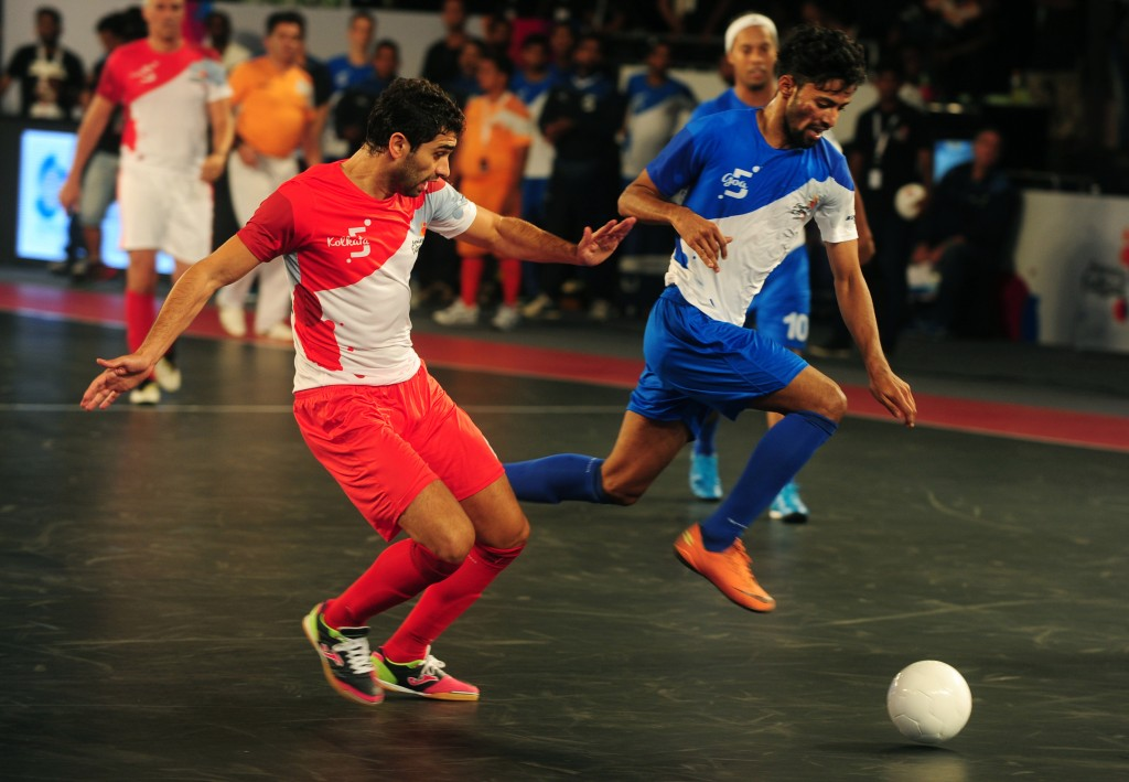 Michael (R) from the Goa 5's plays against Kolkata 5's Gabriel during their Premier Futsal Football League match in Chennai on July 15, 2016. / AFP / ARUN SANKAR (Photo credit should read ARUN SANKAR/AFP/Getty Images)