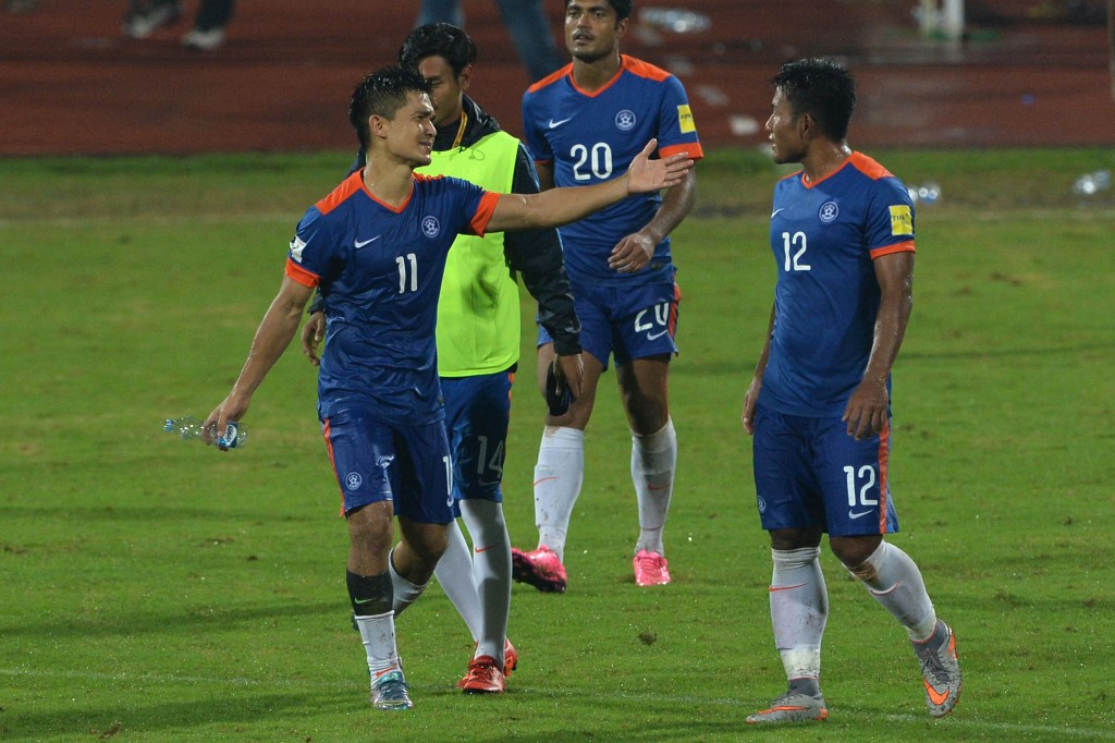 India's Sunil Chhetri (L) gestures towards teammate Je Je (R) after India won 1-0 during the the Asia Group D FIFA World Cup 2018 qualifying football match between India and Guam at The Sree KanteeraVa Stadium in Bangalore on November 12, 2015. AFP PHOTO/ Manjunath KIRAN (Photo credit should read Manjunath Kiran/AFP/Getty Images)