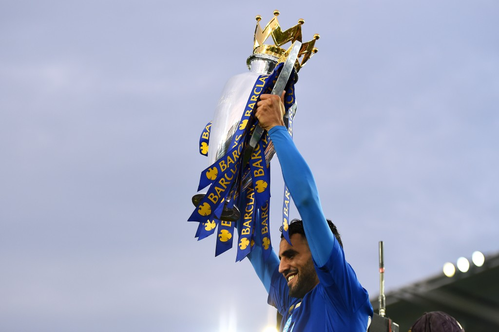 LEICESTER, ENGLAND - MAY 07: Riyad Mahrez of Leicester City lifts the Premier League Trophy as players and staffs celebrate the season champions after the Barclays Premier League match between Leicester City and Everton at The King Power Stadium on May 7, 2016 in Leicester, United Kingdom. (Photo by Laurence Griffiths/Getty Images)