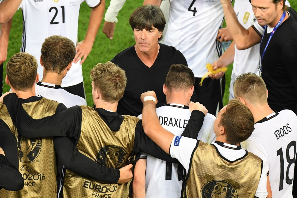 Germany's coach Joachim Loew (C) talks to his players before extra time during the Euro 2016 quarter-final football match between Germany and Italy at the Matmut Atlantique stadium in Bordeaux on July 2, 2016. / AFP / Mehdi FEDOUACH (Photo credit should read MEHDI FEDOUACH/AFP/Getty Images)