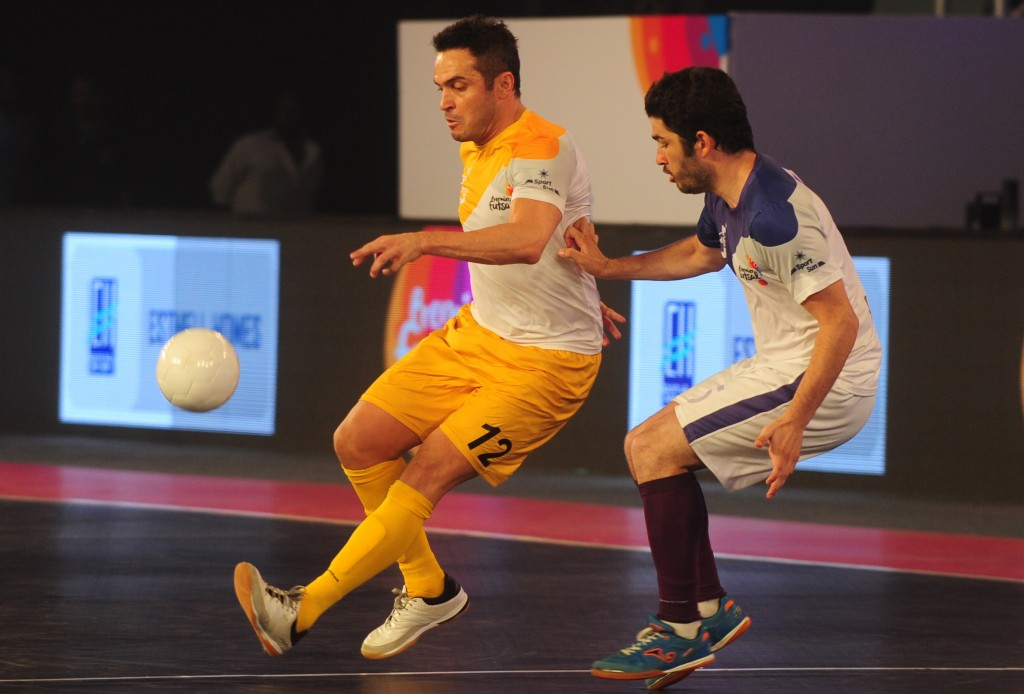 Alessandro Rosa Viera, also known Falcao, from the Chennai 5's plays against the Kochi 5's Gekabert during their Premier Futsal Football League match in Chennai on July 15, 2016 / AFP / ARUN SANKAR (Photo credit should read ARUN SANKAR/AFP/Getty Images)
