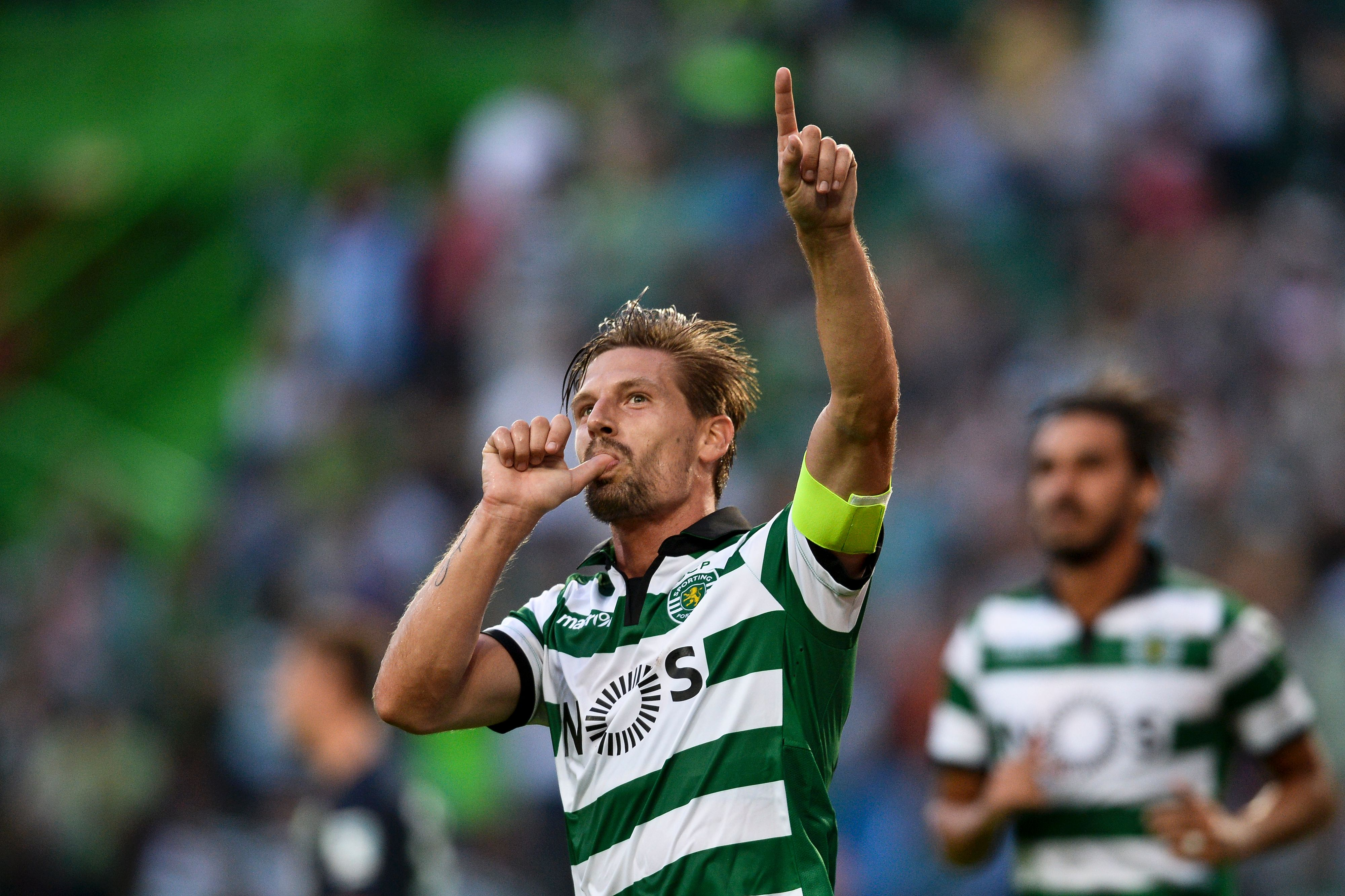 Sporting's midfielder Adrien Silva celebrates after scoring against VFL Wolfsburg during the Violinos Cup football match between Sporting CP and VFL Wolfsburg at Alvalade stadium in Lisbon on July 30, 2016. / AFP / PATRICIA DE MELO MOREIRA (Photo credit should read PATRICIA DE MELO MOREIRA/AFP/Getty Images)