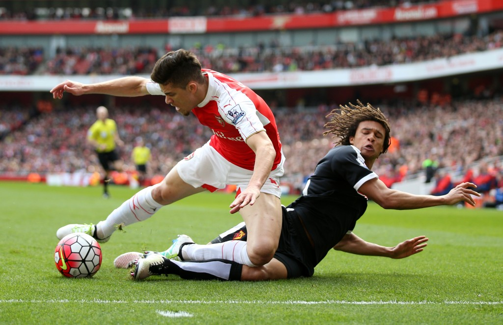 LONDON, ENGLAND - APRIL 02: Gabriel of Arsenal and Nathan Ake of Watford compete for the ball during the Barclays Premier League match between Arsenal and Watford at Emirates Stadium on April 2, 2016 in London, England. (Photo by Ian Walton/Getty Images)