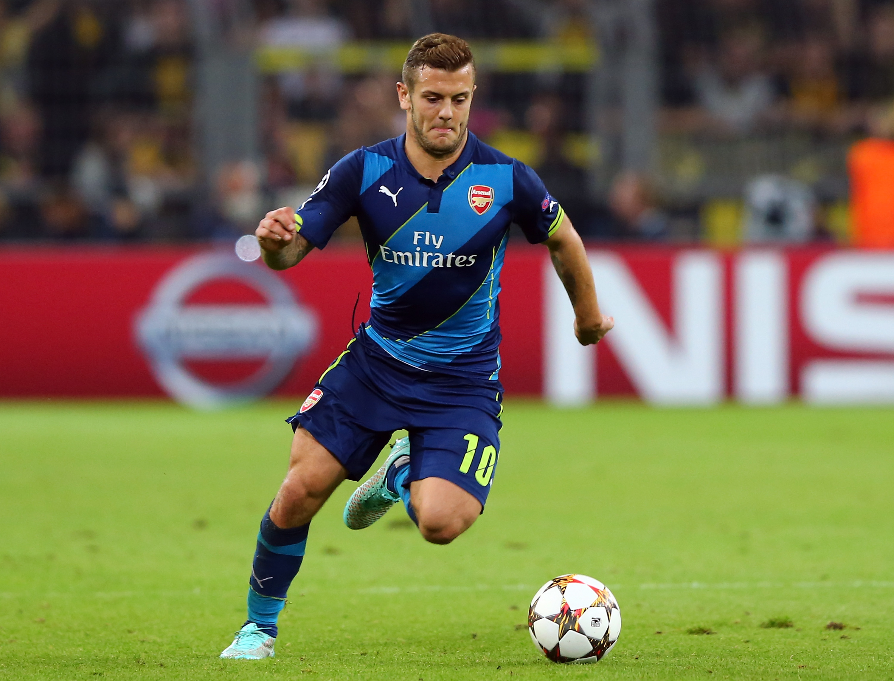 DORTMUND, GERMANY - SEPTEMBER 16: Jack Wilshere of Arsenal London runs with the ball the UEFA Champions League Group D match between Borussia Dortmund and Arsenal London at Signal Iduna Parkon September 16, 2014 in Dortmund, Germany. (Photo by Martin Rose/Bongarts/Getty Images)