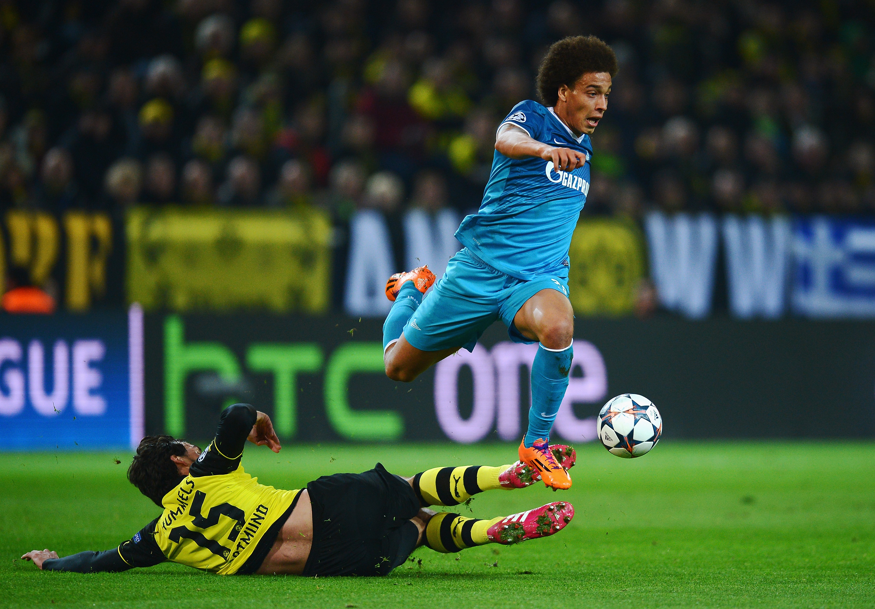 DORTMUND, GERMANY - MARCH 19: Axel Witsel of Zenit is tackled by Mats Hummels of Dortmund during the UEFA Champions League round of 16, second leg match between Borussia Dortmund and FC Zenit at Signal Iduna Park on March 19, 2014 in Dortmund, Germany. (Photo by Lars Baron/Bongarts/Getty Images)