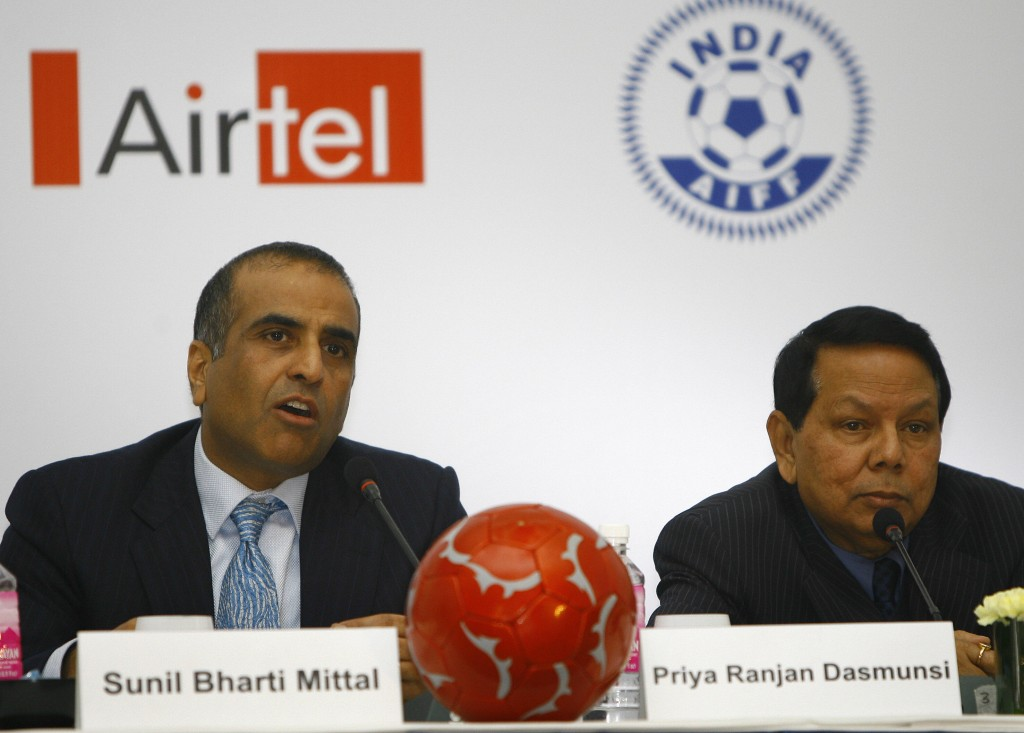 Chairman and Group Chief Executive Officer Bharti Enterprises Sunil Bharti Mittal (L) answers a question as President All India Football Federation (AIFF) Priya Ranjan Dasmunsi (R) looks on after signing a memorandum of understanding in New Delhi, 04 January 2008. Bharti and AIFF will build a comprehensive National Football Development Program (NFDP) and work together for the development of Indian football with the program aimed at delivering the vision of taking India to the World Cup. AIFF in partnership with Bharti, will also design and build a world class talent development programme. AFP PHOTO/ Manpreet ROMANA (Photo credit should read MANPREET ROMANA/AFP/Getty Images)