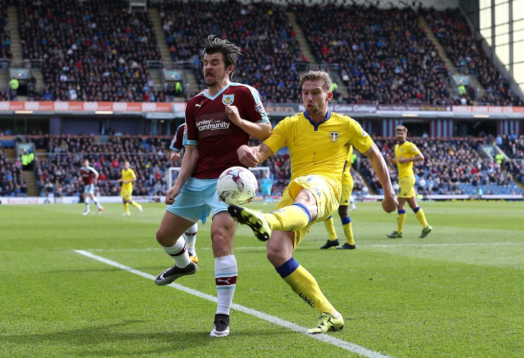 BURNLEY, ENGLAND - APRIL 09:  Charlie Taylor of Leeds clears the ball from Joey Barton of Burnley during the Sky Bet Championship match between Burnley and Leeds United at Turf Moor on April 9, 2016 in Burnley, United Kingdom.  (Photo by Jan Kruger/Getty Images)