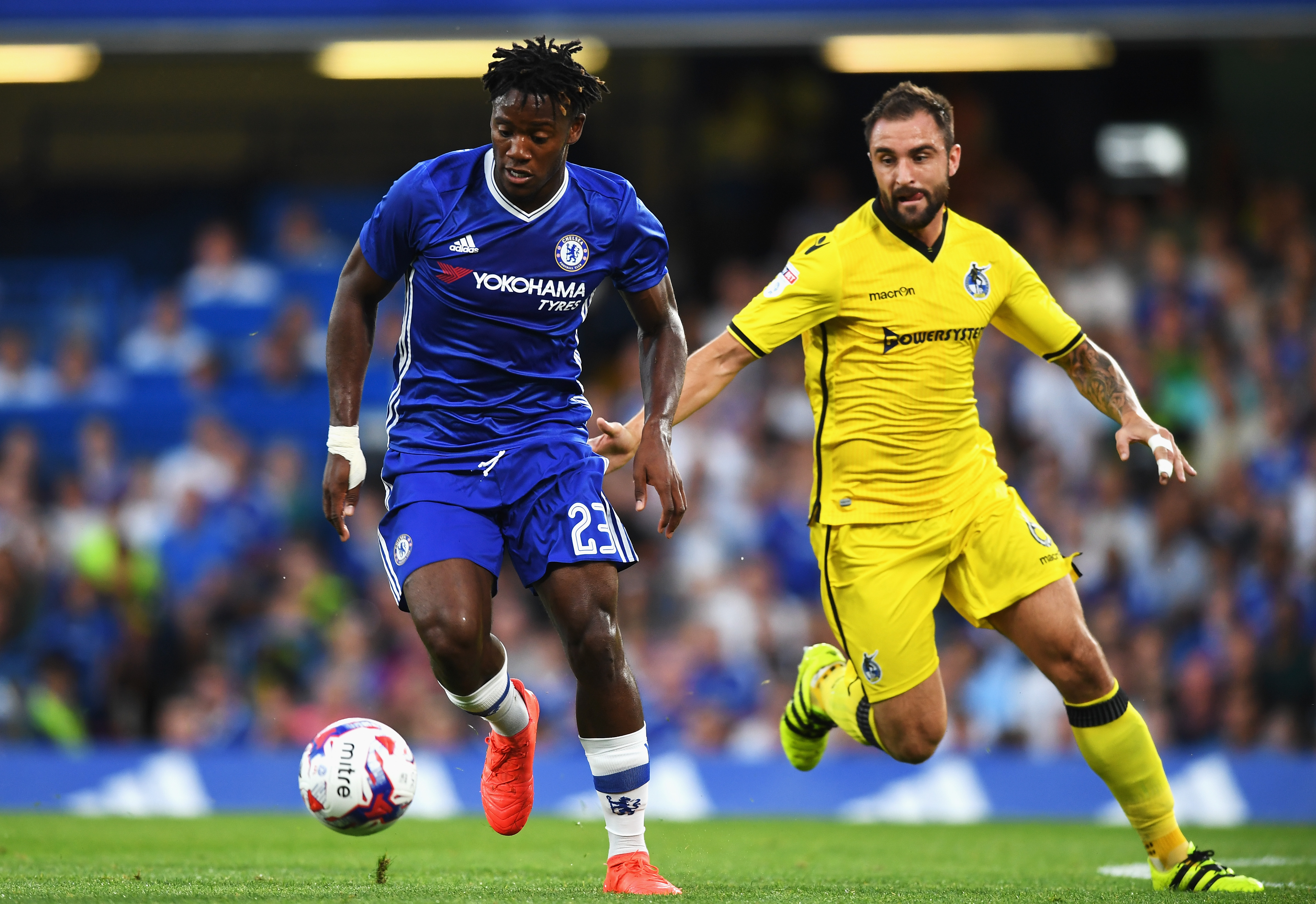 LONDON, ENGLAND - AUGUST 23: Michy Batshuayi of Chelsea is closed down by Peter Hartley of Bristol Rovers during the EFL Cup second round match between Chelsea and Bristol Rovers at Stamford Bridge on August 23, 2016 in London, England. (Photo by Michael Regan/Getty Images )