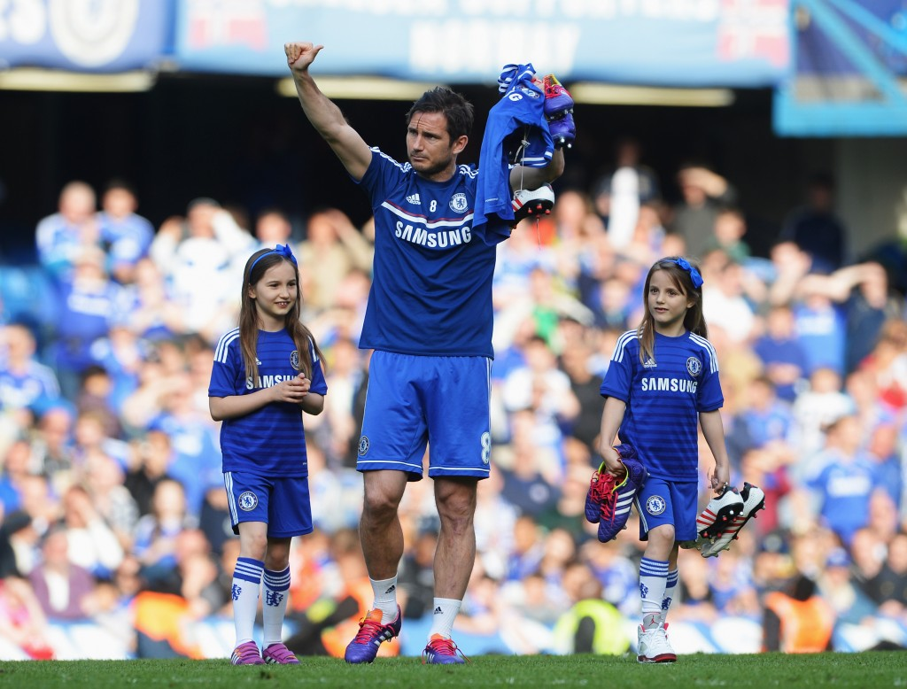 LONDON, ENGLAND - MAY 04: Frank Lampard of Chelsea and his daughters Luna and Isla appear on the pitch following the Barclays Premier League match between Chelsea and Norwich City at Stamford Bridge on May 4, 2014 in London, England. (Photo by Michael Regan/Getty Images)