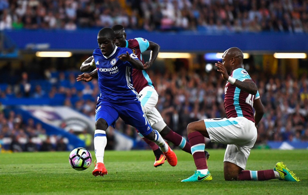 LONDON, ENGLAND - AUGUST 15: N'Golo Kante of Chelsea makes a break past Andre Ayew (R) of West Ham United during the Premier League match between Chelsea and West Ham United at Stamford Bridge on August 15, 2016 in London, England. (Photo by Mike Hewitt/Getty Images)