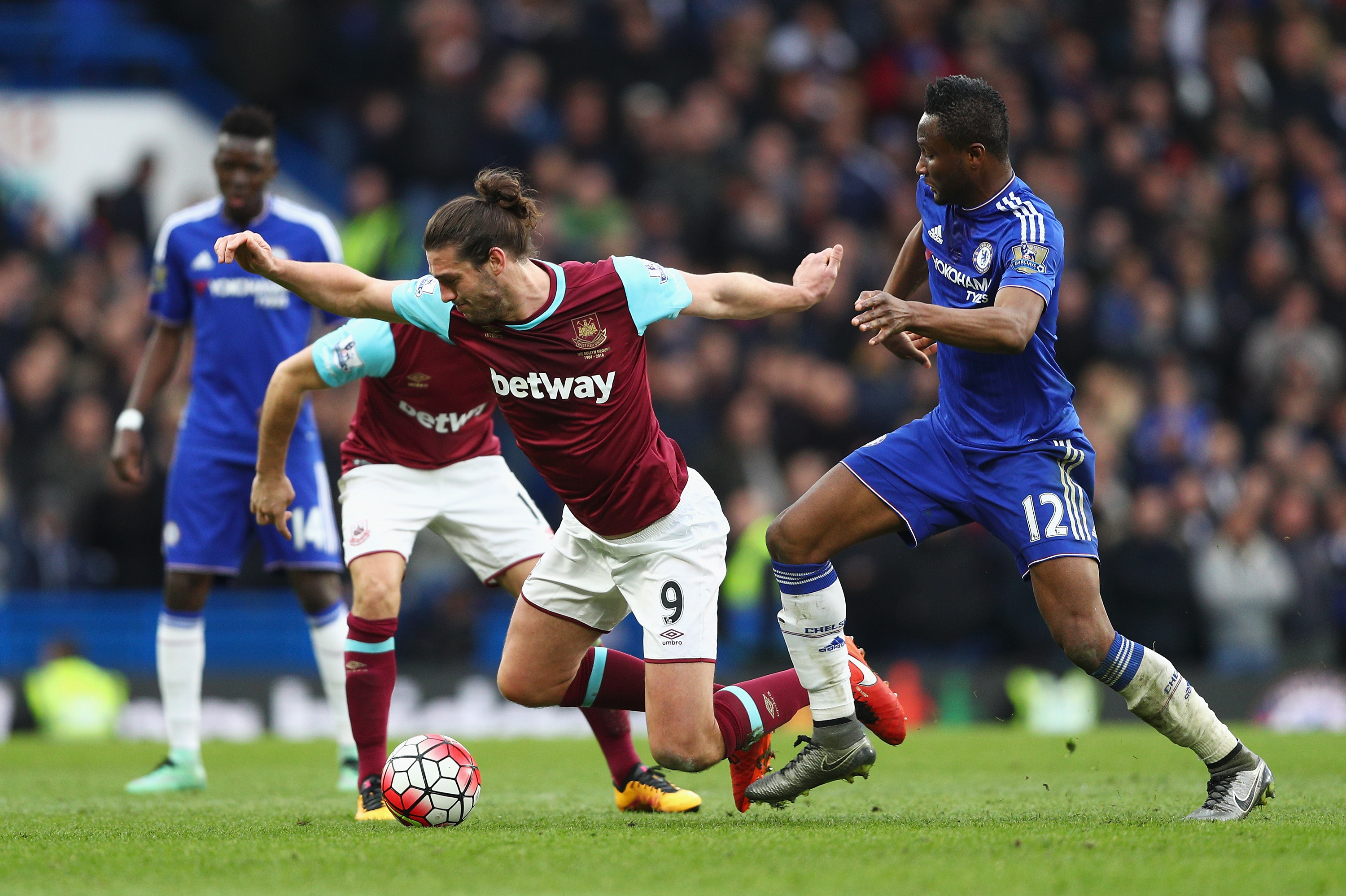 LONDON, ENGLAND - MARCH 19: Andy Carroll of West Ham United is challenged by John Mikel Obi of Chelsea during the Barclays Premier League match between Chelsea and West Ham United at Stamford Bridge on March 19, 2016 in London, United Kingdom. (Photo by Paul Gilham/Getty Images)