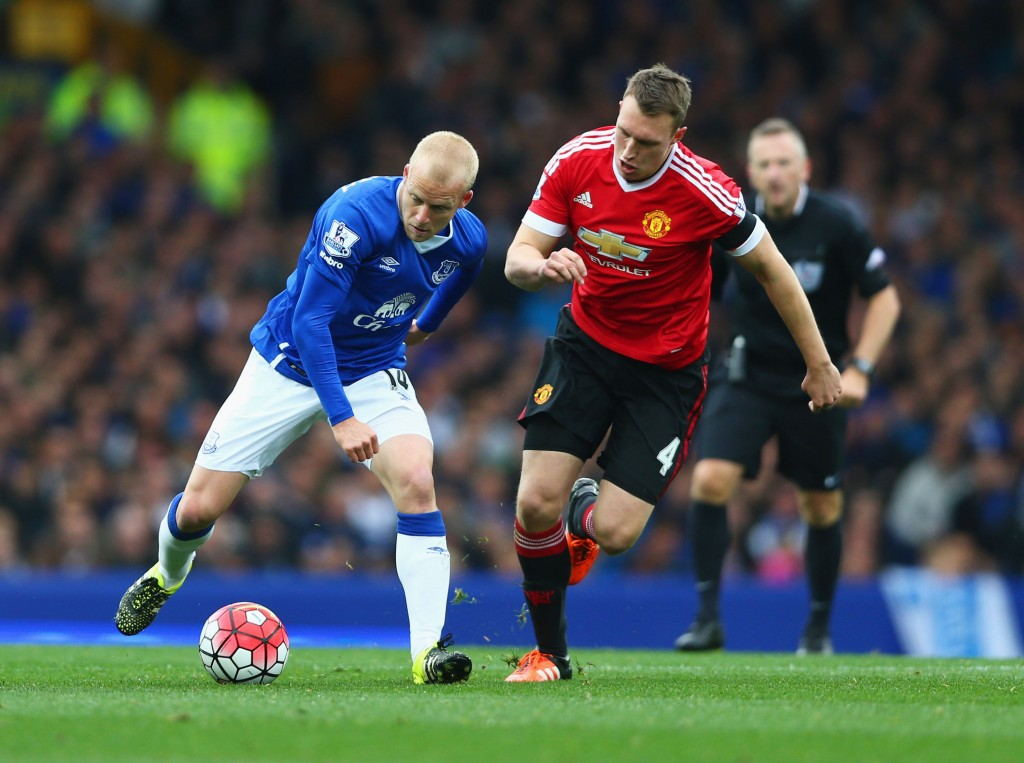 LIVERPOOL, ENGLAND - OCTOBER 17: Steven Naismith of Everton and Phil Jones of Manchester United compete for the ball during the Barclays Premier League match between Everton and Manchester United at Goodison Park on October 17, 2015 in Liverpool, England. (Photo by Clive Brunskill/Getty Images)