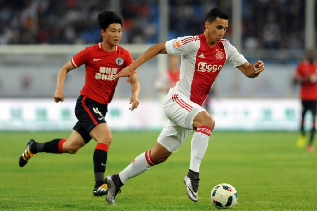 El-Ghazi Anwar (R) of Ajax Amsterdam controls the ball during a friendly match against Chinese Super League club Liaoning Whowin FC in Shenyang, northeast China's Liaoning province on May 18, 2016. / AFP / - (Photo credit should read -/AFP/Getty Images)