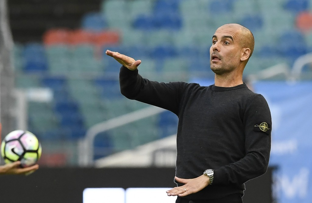 Manchester City's Spanish head coach Pep Guardiola reacts during the friendly football match between Arsenal and Manchester City at the Ullevi stadium in Gothenburg on August 7, 2016. (Photo credits: Jonathan Nackstrand/AFP/Getty Images)