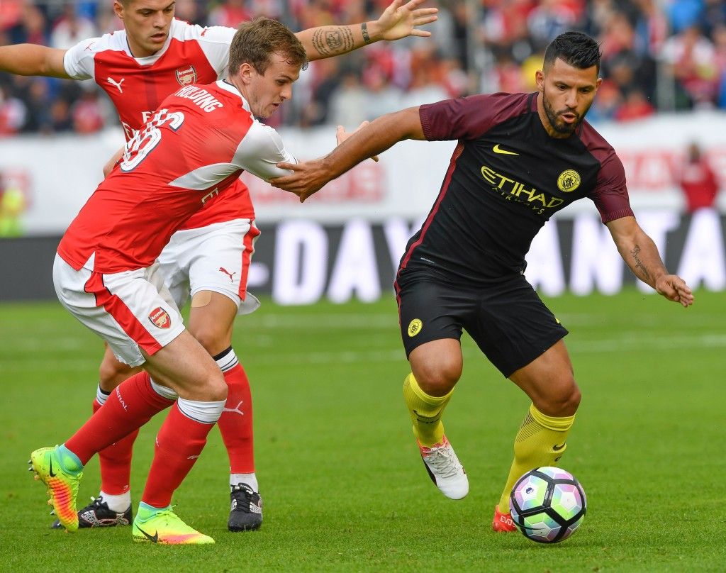 Arsenal's English defender Rob Holding (L) vies with Manchester City's Argentinian forward Sergio Aguero during the friendly football match between Arsenal and Manchester City at the Ullevi stadium in Gothenburg on August 7, 2016. / AFP / JONATHAN NACKSTRAND (Photo credit should read JONATHAN NACKSTRAND/AFP/Getty Images)