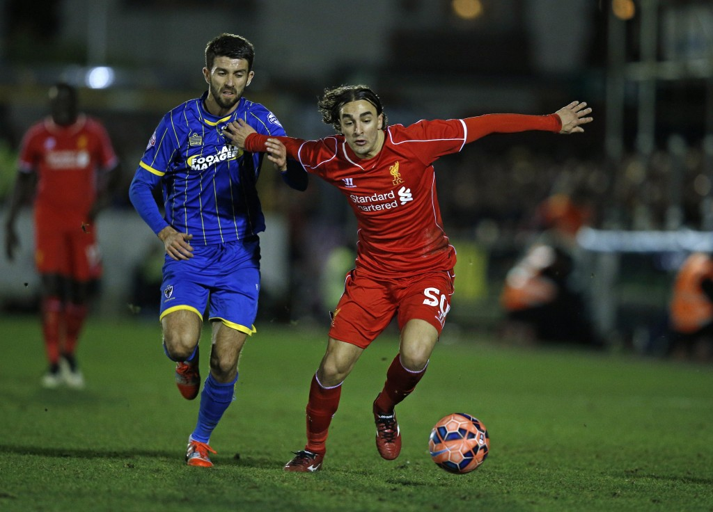 Liverpool's Serbian midfielder Lazar Markovic (R) vies with AFC Wimbledon's English defender George Francomb (L) during the English FA Cup third round football match between AFC Wimbledon and Liverpool at The Cherry Red Records Stadium in Kingston Upon Thames, south west London on January 5, 2015. AFP PHOTO / ADRIAN DENNIS RESTRICTED TO EDITORIAL USE. No use with unauthorized audio, video, data, fixture lists, club/league logos or live services. Online in-match use limited to 45 images, no video emulation. No use in betting, games or single club/league/player publications. (Photo credit should read ADRIAN DENNIS/AFP/Getty Images)