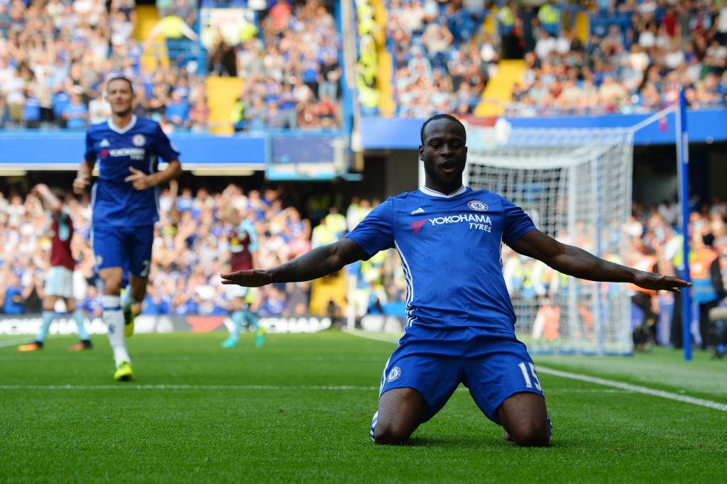 Chelsea's Nigerian midfielder Victor Moses celebrates after scoring during the English Premier League football match between Chelsea and Burnley at Stamford Bridge in London on August 27, 2016. (Photo by Glyn Kirk/AFP/Getty Images)