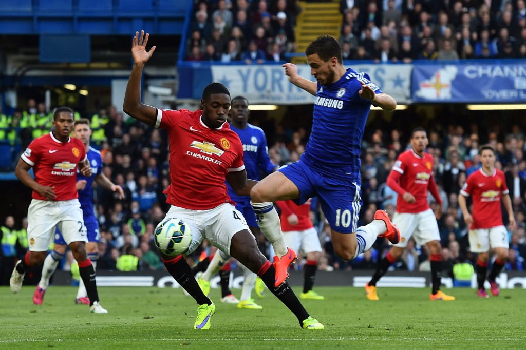 Chelsea's Belgian midfielder Eden Hazard (3R) tries to get past Manchester United's English defender Tyler Blackett (2L) during the English Premier League football match between Chelsea and Manchester United at Stamford Bridge in London on April 18, 2015. AFP PHOTO / BEN STANSALL RESTRICTED TO EDITORIAL USE. No use with unauthorized audio, video, data, fixture lists, club/league logos or live services. Online in-match use limited to 45 images, no video emulation. No use in betting, games or single club/league/player publications. (Photo credit should read BEN STANSALL/AFP/Getty Images)