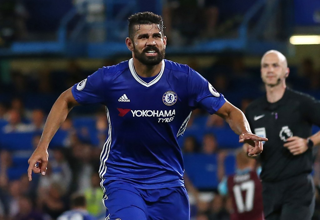 Chelsea's Brazilian-born Spanish striker Diego Costa celebrates after scoring their second goal during the English Premier League football match between Chelsea and West Ham United at Stamford Bridge in London on August 15, 2016. Chelsea won the game 2-1. (Photo credit: Justin Tallis/AFP/Getty Images)