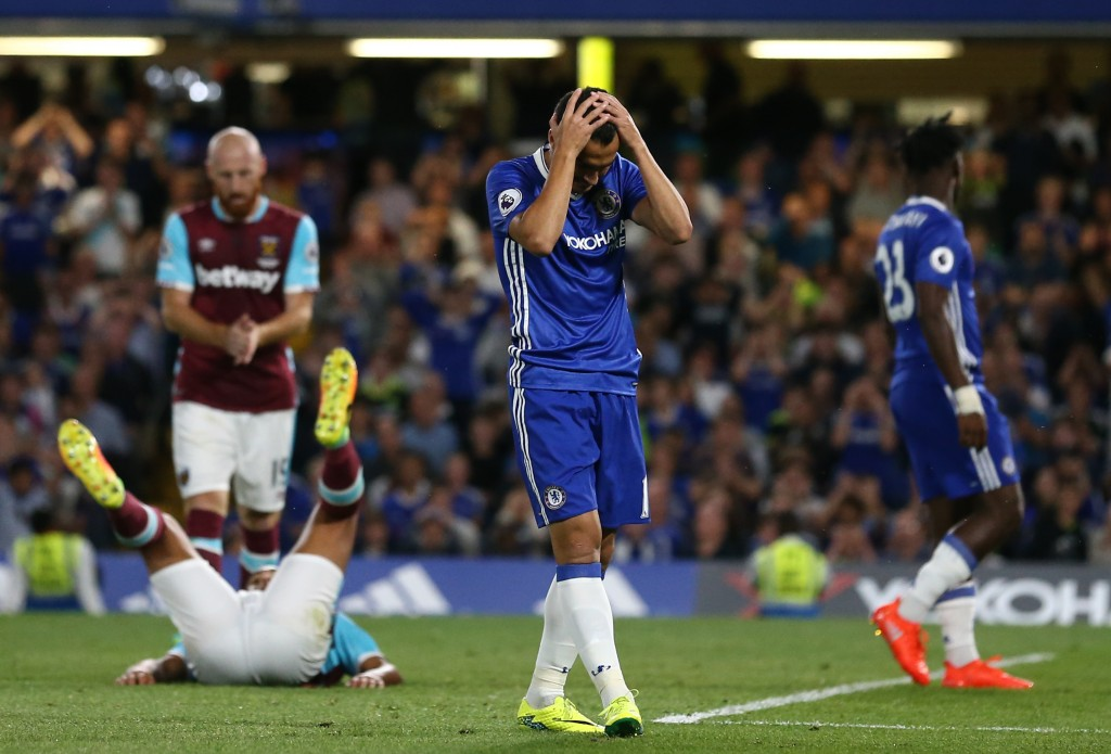 Chelsea's Spanish midfielder Pedro reacts after missing a chance during the English Premier League football match between Chelsea and West Ham United at Stamford Bridge in London on August 15, 2016. / AFP / Justin TALLIS / RESTRICTED TO EDITORIAL USE. No use with unauthorized audio, video, data, fixture lists, club/league logos or 'live' services. Online in-match use limited to 75 images, no video emulation. No use in betting, games or single club/league/player publications. / (Photo credit should read JUSTIN TALLIS/AFP/Getty Images)