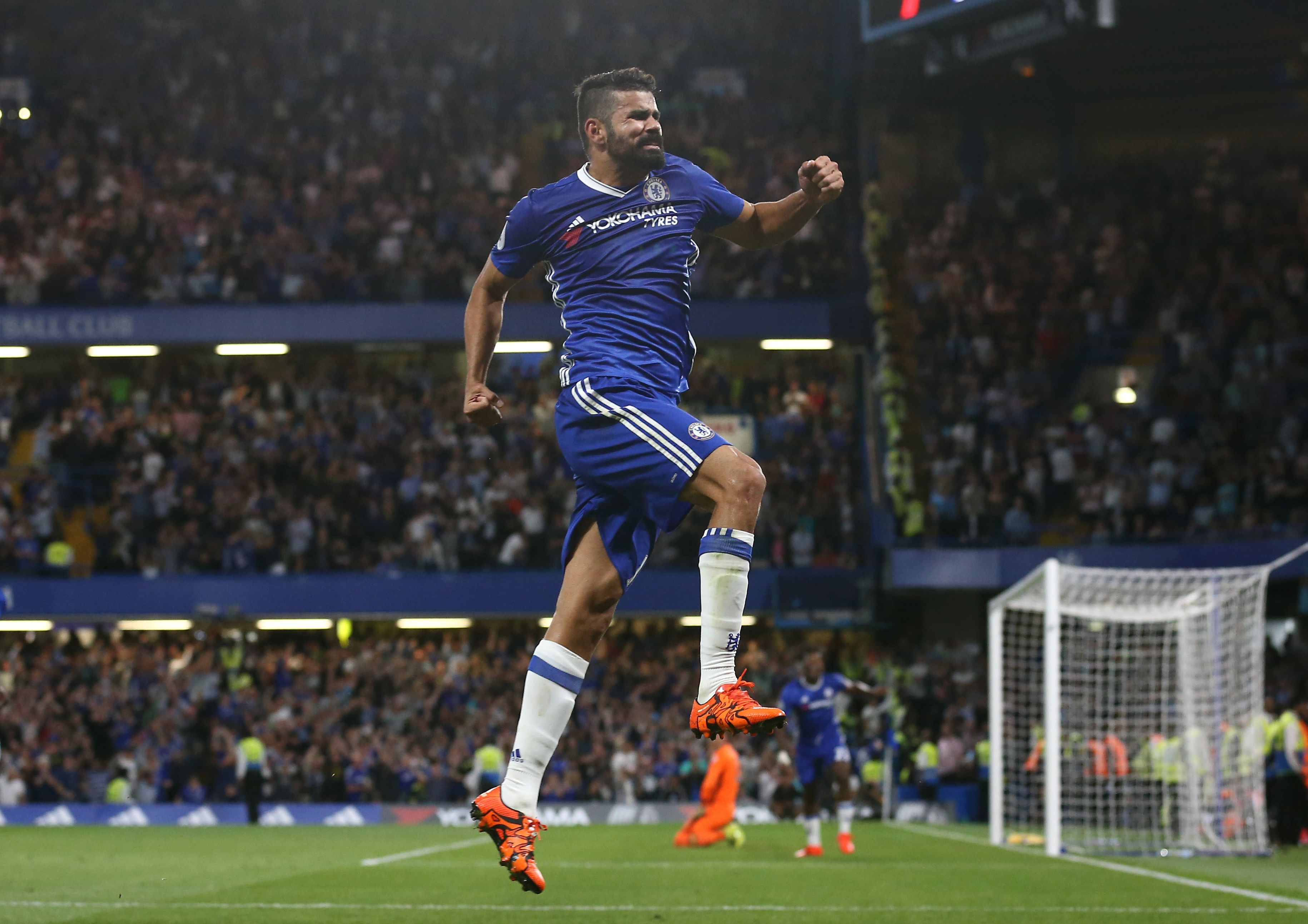 Chelsea's Brazilian-born Spanish striker Diego Costa celebrates after scoring their second goal during the English Premier League football match between Chelsea and West Ham United at Stamford Bridge in London on August 15, 2016. / AFP / Justin TALLIS / RESTRICTED TO EDITORIAL USE. No use with unauthorized audio, video, data, fixture lists, club/league logos or 'live' services. Online in-match use limited to 75 images, no video emulation. No use in betting, games or single club/league/player publications. / (Photo credit should read JUSTIN TALLIS/AFP/Getty Images)