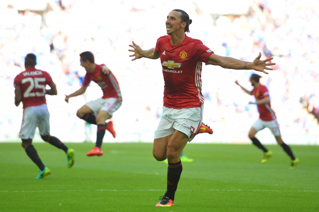 Manchester United's Swedish striker Zlatan Ibrahimovic celebrates scoring their second goal during the FA Community Shield football match between Manchester United and Leicester City at Wembley Stadium in London on August 7, 2016. / AFP / GLYN KIRK / NOT FOR MARKETING OR ADVERTISING USE / RESTRICTED TO EDITORIAL USE (Photo credit should read GLYN KIRK/AFP/Getty Images)