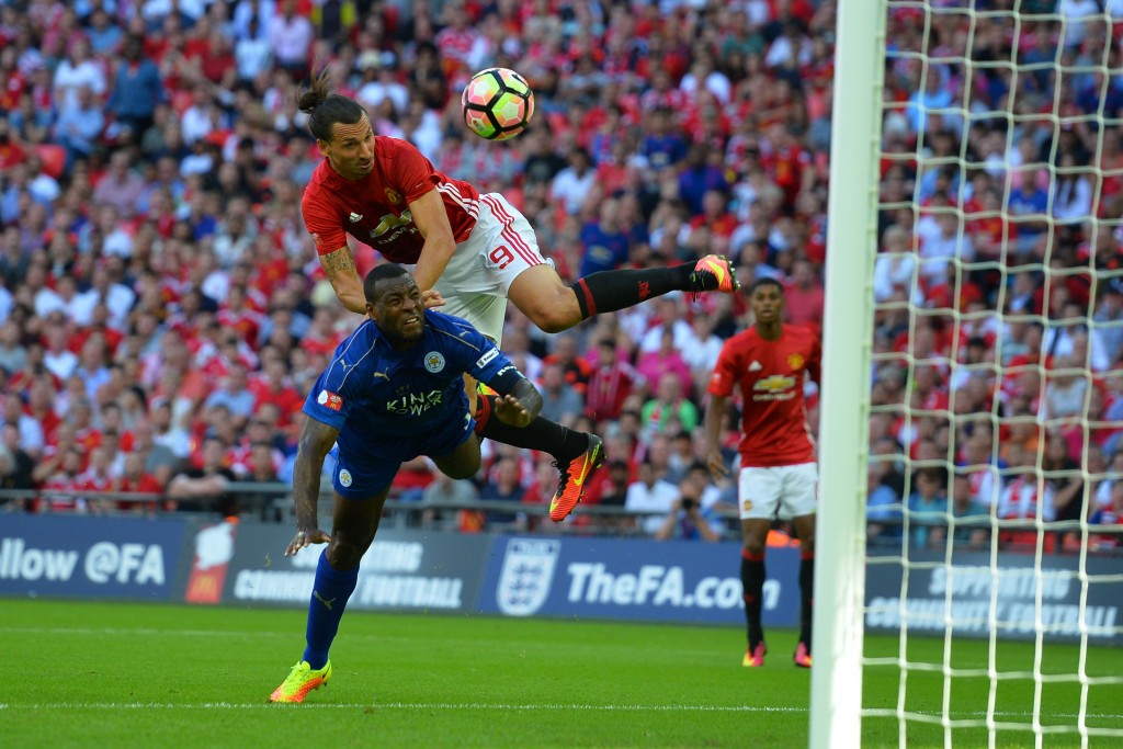 Wes Morgan was outdone by Zlatan as he towered above the strong defender to slot home United's winner. (Picture Courtesy - AFP/Getty Images)