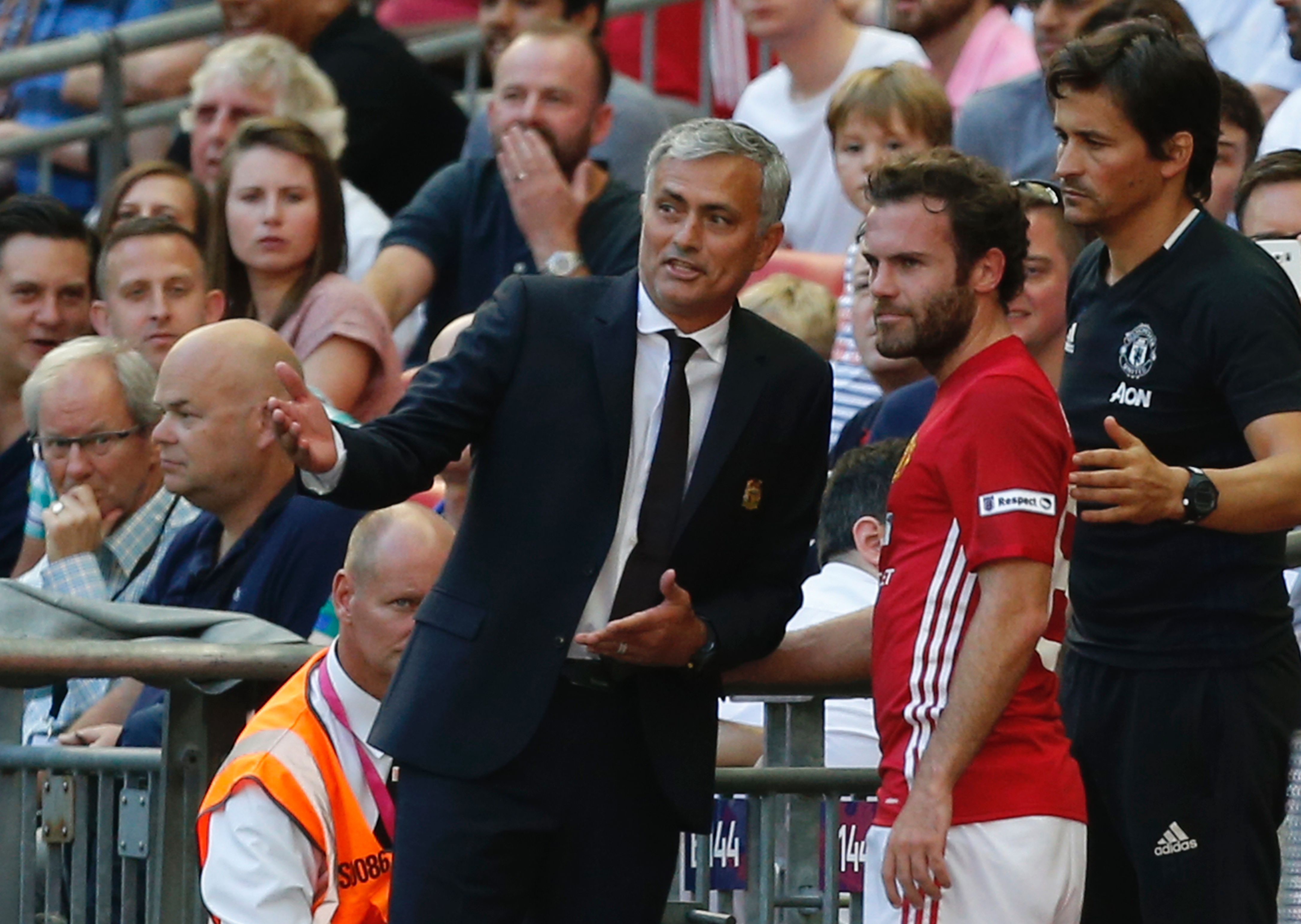 Manchester United's Spanish midfielder Juan Mata (C) talks with Manchester United's Portuguese manager Jose Mourinho (L) and Manchester United's Portuguese assistant manager Rui Faria (R) after he is substituted late on during the FA Community Shield football match between Manchester United and Leicester City at Wembley Stadium in London on August 7, 2016. / AFP / Ian Kington / NOT FOR MARKETING OR ADVERTISING USE / RESTRICTED TO EDITORIAL USE (Photo credit should read IAN KINGTON/AFP/Getty Images)