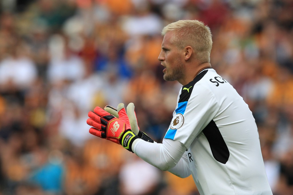 Leicester City's Danish goalkeeper Kasper Schmeichel reacts during the English Premier League football match between Hull City and Leicester City at the KCOM Stadium in Kingston upon Hull, north east England on August 13, 2016. (Photo credit: Lindsey Parnaby/AFP/Getty Images)